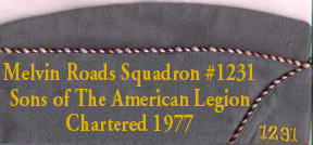 Squadron Cap, right side, (front -->) has the squadron number embrodered (front, lower right).  